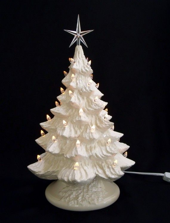 Dreaming of a White Christmas? White Christmas Ceramic Christmas Tree with white base, music box, and over 50 white (clear) lights to shine for