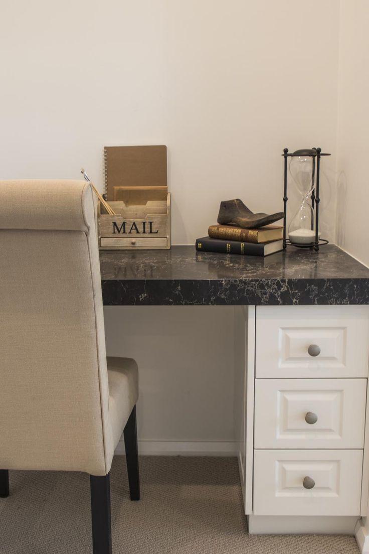 Vintage accessories paired with an elegant Caeserstone Built-In Desk - a captivating combination. Visit this home at Gilleston Heights http://www.mcdonaldjoneshomes.com.au/display-home-locations/wallis-creek-ii #countryinteriordesign #mcdonaldjones #mcdonaldjoneshomes