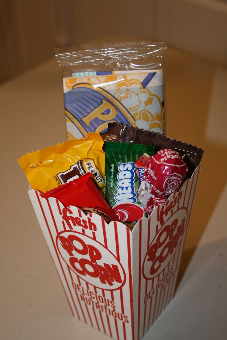 Movie Theater themed birthday party- Goody bags filled with mini popcorn bags, Airheads (bought bags from the dollar bin at Target, Tootsie pops (bunches of 8 for 1 dollar) and candy from the concession stand. Popcorn boxes bought at Target were 8 for 3 dollars.