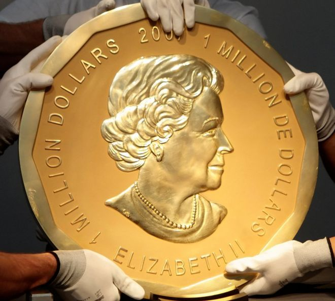 """The """"Big Maple Leaf"""" (photo courtesy of Reuters) Dateline March 28, 2017: A giant gold maple leaf coin has been stolen from a museum in Germany. According to the BBC, the the super-sized coin was taken at night from the Bode Museum in Berlin. The """"Big Maple Leaf"""" Nicknamed the """"Big Maple Leaf"""", the enormous coin was minted by the Royal Canadian Mint in 2007. The coin is 3cm. (1.18 in) thick, 53 cm. (20.9 in.) in diameter, and carries a likeness of Queen Elizabeth II on its obverse, as…"""