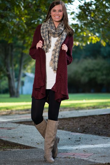 Your first fashion love may not have been a cardigan, but we know this one will be one of your favorites! The material is oh-so cozy, perfect for snuggling into on a brisk day! With a gorgeous burgundy color that we don't see enough of, this stand-out cardi is just the thing for your fall closet! <br /> <br />Material has generous amount of stretch. <br />Sara is wearing the size small/medium. <br /> <br />Sizes fit: <br />Small/Medium- 0-6; Medium/Large- 8-12 <br />Length from shoulder…