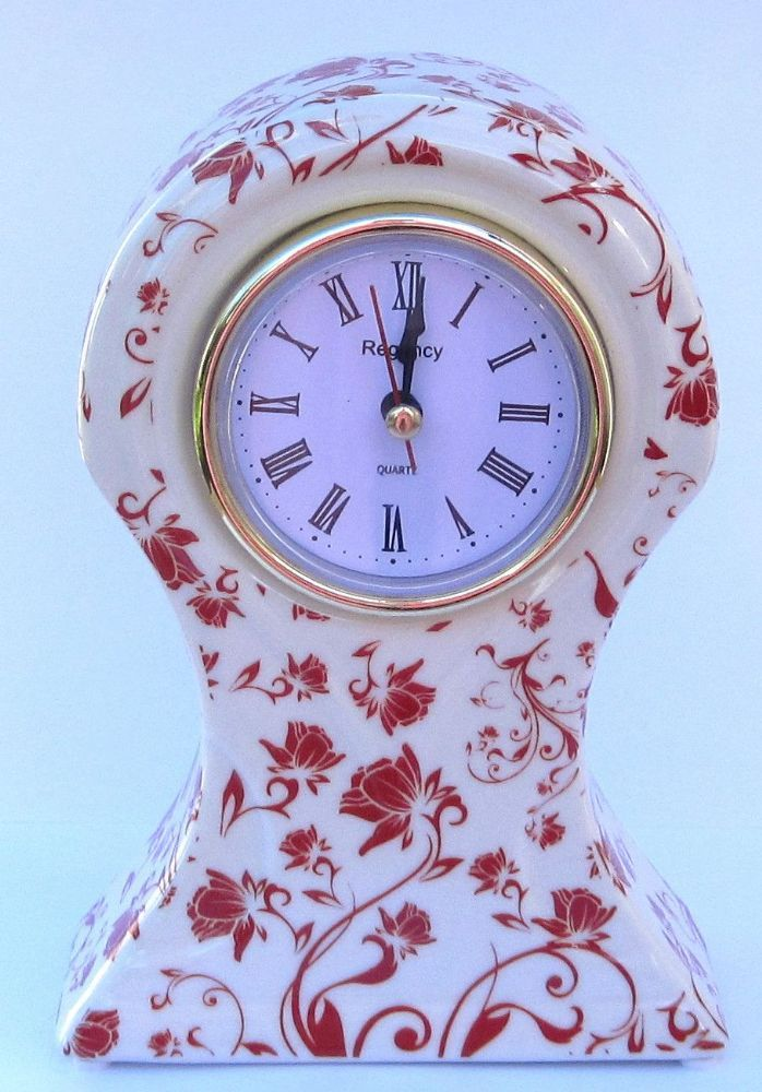 This stunning ceramic cream mantel clock has a stylish red floral design Made from quality ceramic Measures 15 5 cm in height and 10 cm in width The