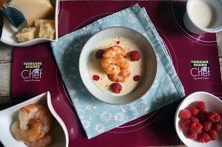 Crema di Parmigiano con gamberi saltati e lamponi