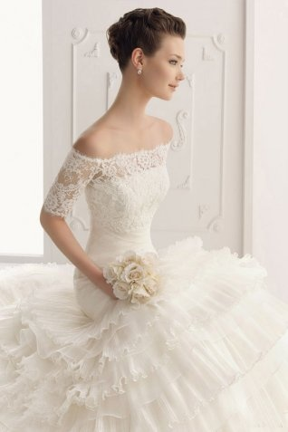 not sure about the tulle ruffles but i love the neckline off the shoulders