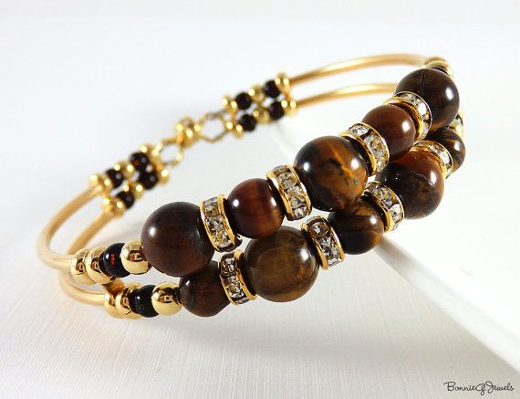 Memory Wire Bracelet handmade by me using a combination of Tigers Eye Beads, Gold Finish Noodle Tubes, Czech Seed Beads, Crystal Rondelles and Gold