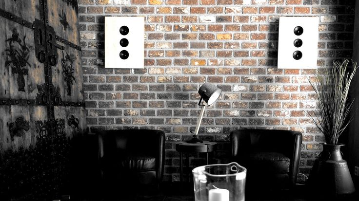 This artistic, dramatic picture, taken from Housing Fair 2015 Vantaa, shows how Sonolux Bebop 2 on wall speakers can complement an existing interior, without dominating it.  Other furniture are from Aada Sisustus. Picture taken by Lars Kastilan