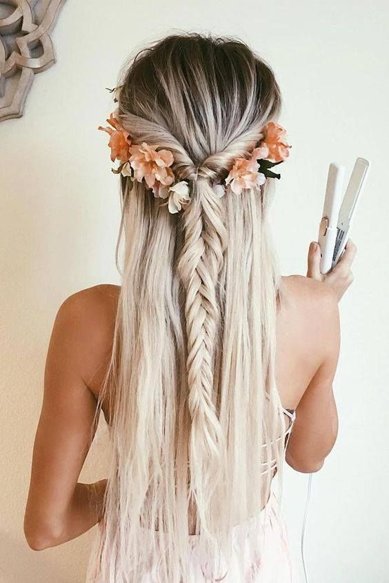 A fishtail plait with flowers makes the cutest bridal hair