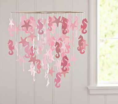 "really love this pretty paper mobile! It's an ideal inspiration piece for a sea-side or ""at the beach""…5. Beach-side  Price: $39.00 at potterybarnkids.comI"