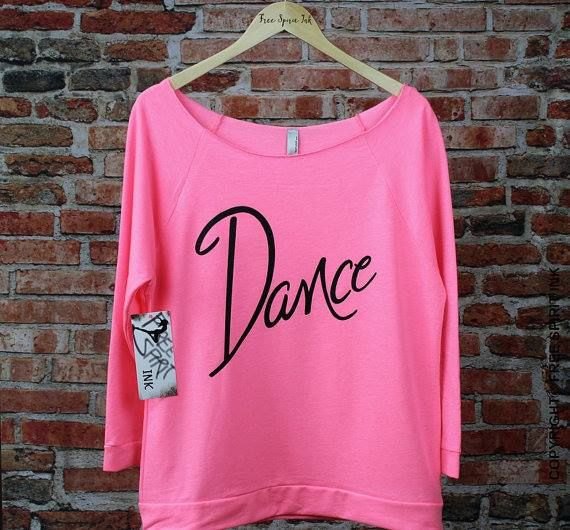 Off the shoulder 3/4 sleeve raglan made with a very soft ring-spun cotton and polyester blend for a lightweight and extremely comfortable fit. This fabulous shirt makes the perfect gift for any dancer! $23.99.  Name can be added for an additional fee.  3 colors available with option for different color text.   All About Attitude Dancewear