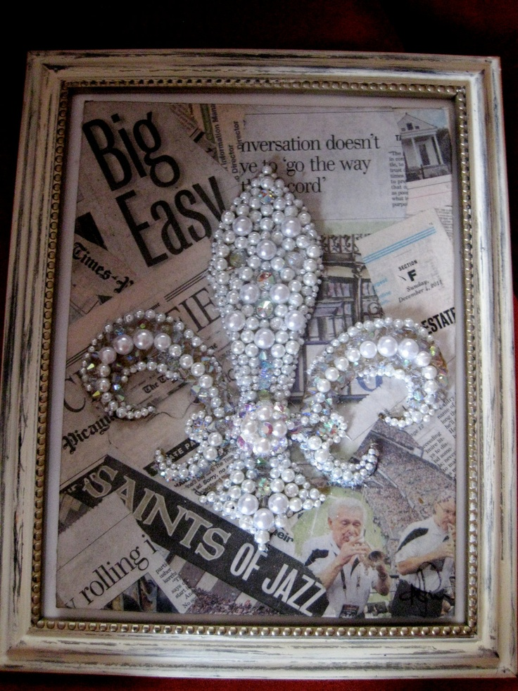 Love it! From Amanda's Etsy shop  pearl and swaroski crystal jeweled fleur de lis on collage new orleans newspaper canvas w/ distressed frame. $85.00, via Etsy.