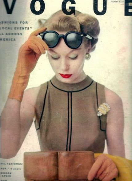 Smart sharp chic as seen in Vogue, Summer 1951. Pale mocha shaded sleeveless linen, obligatory sunglasses and unexpected orange sherbet shaded gloves.