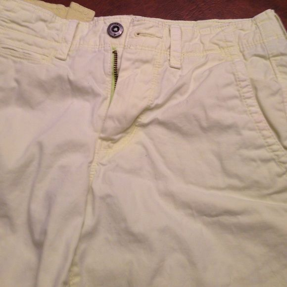Yellow American Eagle shorts size 26 MENS Yellow American Eagle men's shorts size 26. Slight neon tint. Excellent condition. No holes or stains. Priced to reduce for reduced shipping. American Eagle Outfitters Shorts Flat Front