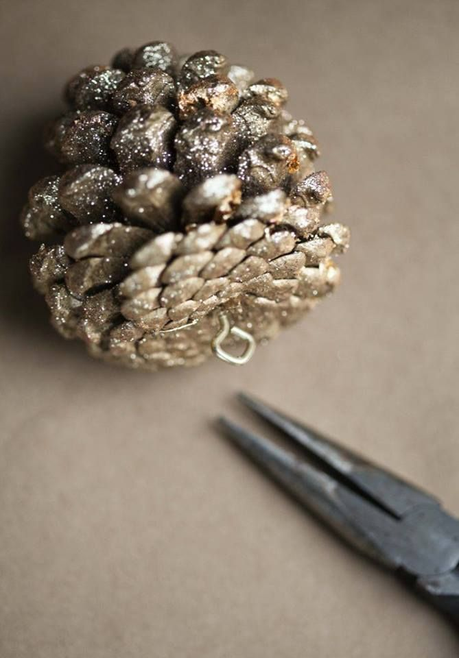 Putting a small screw in the bottom of pine cones helps make it easier to hang them on the tree or in garland.