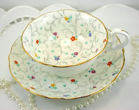 Lovely, Radfords Teacup & Saucer, Delicate Floral Pattern, Gold Rims, Bone English China made in 1950s. In good condition, no chips, cracks, crazing or repars. The Saucer measures-5.5(14cm) in diameter. The Cup opening-4(10cm), with the Handle-5(12.5cm) The Height-2.2(5.cm)