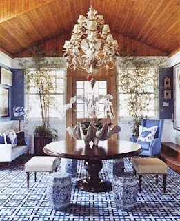 Love the giant clam shell, the colors, the plants, the rug, the wood ceiling, and the little stools.