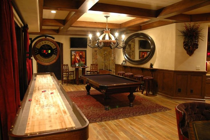 Wall paneling with rail. Also shuffle board table, light wood floors, ceiling beams