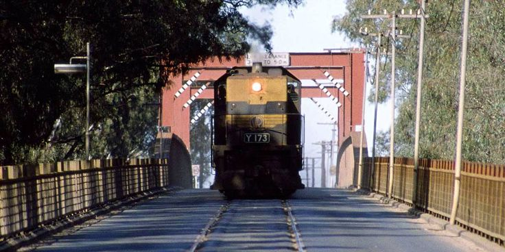 train on the old Echuca Murray River bridge. A new bridge for the railway line has since been built adjacent.