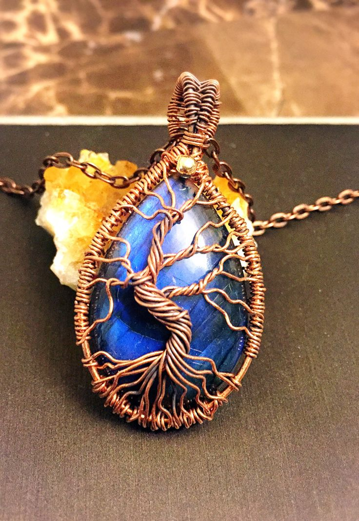 A personal favorite from my Etsy shop https://www.etsy.com/ca/listing/550397222/double-sided-tree-of-life-pendant-blue