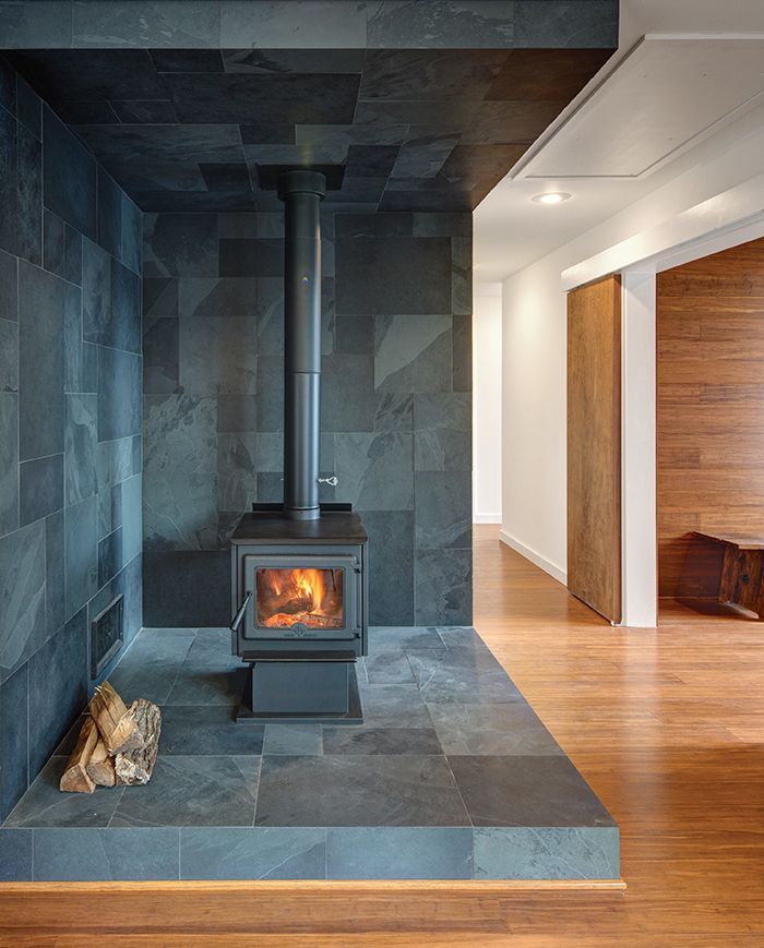 True North wood stove  Vermont slate. Wide-plank Yanachi Carbonized Strand Woven Bamboo covers the floors