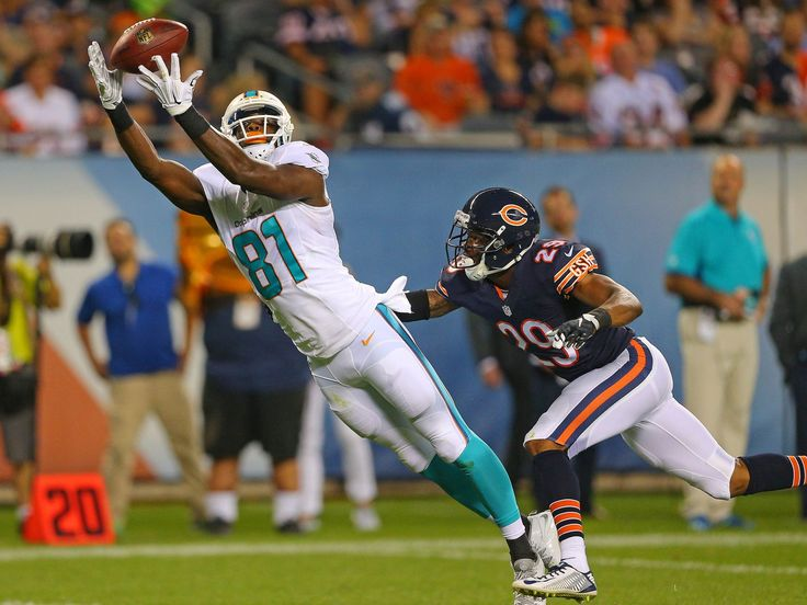Miami Dolphins wide receiver LaRon Byrd makes a catch over Chicago Bears defensive back Al Louis-Jean during the second quarter of a preseason NFL football game in Chicago.  Dennis Wierzbicki, USA TODAY Sports