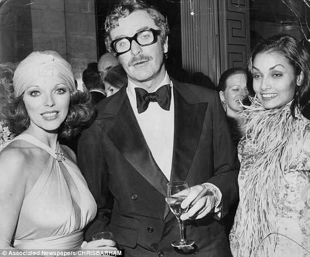 Long-time pals: Joan Collins, actor Michael Caine and his wife Shakira at fashion evening at the Savoy Hotel, London in 1974