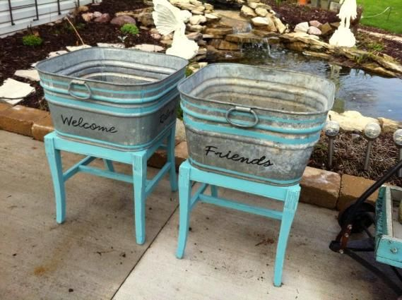 Ann's galvanized tubs sit on just the legs of discarded chairs.       I like the painted stripes on the tubs