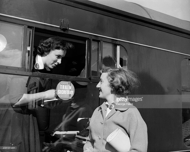 Train Secretaries: Ann Lowe (left) chatting to June Lambert at Willesden Junction [NW London], both women are to start work as secretaries on trains from London Euston to Manchester.