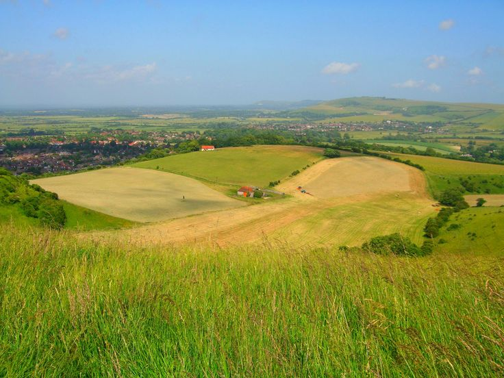 https://flic.kr/p/84bnEh | Editors choice - South Downs Near Steyning | Published in June 2010 Sussex Life Magazine.  With similar description...  The picturesque West Sussex South Downs.  The terrain and crops create the patchwork quilt landscape that England is famous for.  I did not intend to take this shot but saw the scenery with the town of Steyning framed by the countryside and as I had the camera pulled over and captured this moment.