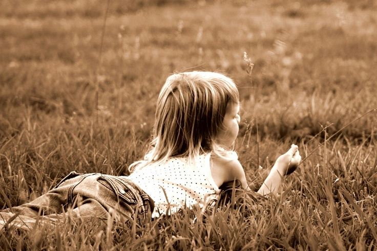 field pics ~ girl lying in grass photo ~ sepia ~ child photography session ~ outdoor ideas ~ shoot with natural light / lighting ~ portrait ~ moments i've captured ... - april allen P H O T O G R A P H Y ~ Chesapeake VA ~ Hampton Roads photographer