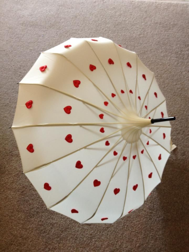 .Ivory Edwardian Style Umbrella with Cascade of Red Heart Design by Love Umbrellas.                 t