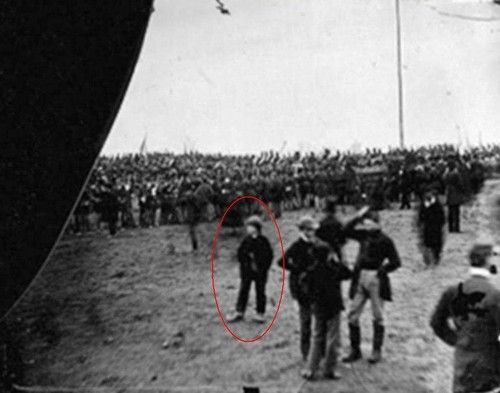"This Man States He Is A Time Traveler and Is In The Picture Of The Gettysburg Address  ""Andrew D. Basiago, 10, at Gettysburg, PA, on November 19, 1863, after being sent there from 1972 by DARPA's Project Pegasus via a ""plasma confinement chamber"" in East Hanover, NJ. Andy is the boy standing to the left in the foreground of the image. He is wearing the large shoes that were given to him by Gettysburg cobbler John Burns after he walked into Gettysburg barefoot and shiv"