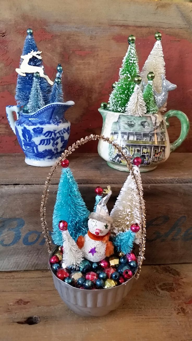 Three Christmas gardens made from vintage creamers and jello molds, tins, with bottle brush trees and glass beads from vintage garlands