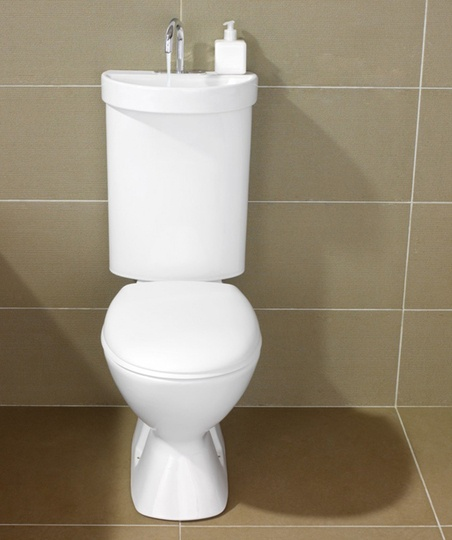Very interesting:  combo toilet and sink (this model from Caroma), the water you use in the sink goes down a drain and into toilet tank where it gets used the next time you flush!  Weird ~ maybe~ but pretty eco-friendly.  Would be great in tight spaces, like under stairs...  #toilet #sink #stairs #ecofriendly