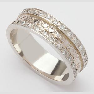 THIS IS MY SECOND CHOICE. This is actually gorgeous, and so classy, and wouldn't snag on anything. Definitely one of my top choices. 14K Celtic Claddagh Wedding Band