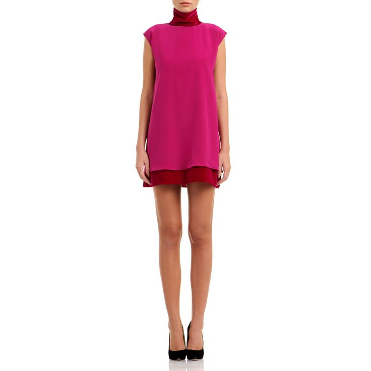 This style will steal the show by combining crepe de chine and velvet made of silk in matching shades. It's finished with a cozy turtleneck and velvet hem that subtly define the slouchy silhouette. Magenta crepe de chine and velvet 100% silk 100% viscoze lining Fluid textil Dry clean only The model is 176 cm tall and is wearing a size 38. If you need this product made to fit your needs and measures, book an appointment in our studio at i@laurahincu.ro for Private Fashioning.