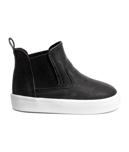 Black. High-top, pull-on sneakers in imitation leather with elastic side panels and a loop at back. Cotton canvas lining, cotton canvas insoles, and rubber