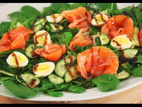 Spinach salad with Quail Eggs and Salmon. Paleo diet food