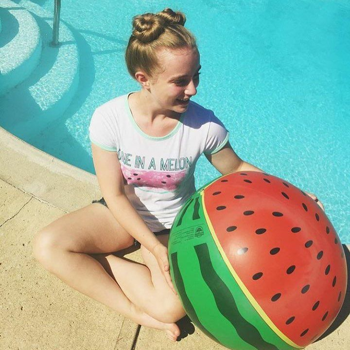 Sam our team lead at our Southcentre location loves fun in the sun with her one in a melon Kira Tee! #tripleflip #graphictee