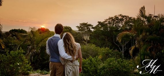 Watching the sunset on their big day..  Jen and Freddie, Byron Bay Australia, Wedding Ceremony and Reception Venue - Gurragawee.  Destination weddings with an arty, bohemian vibe set in the Byron Bay hinterland. Copyright: MM Photos