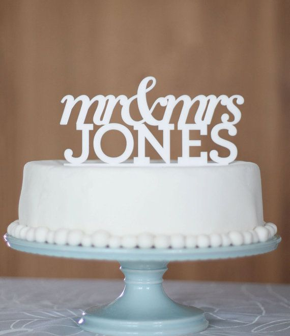 Custom wedding cake toppers. $45.00, via Etsy. | this would be super cute if Rob's last name wasn't Schwiebert... :(
