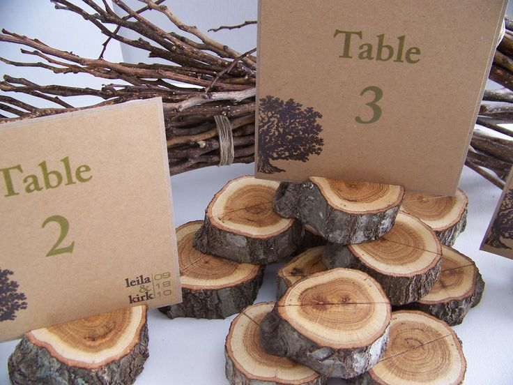 Adorable. Stack table cards on tiny wood chunks.