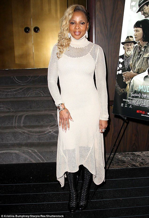 Hot mesh! Mary J. Blige meanwhile wore a white mesh dress with a turtleneck