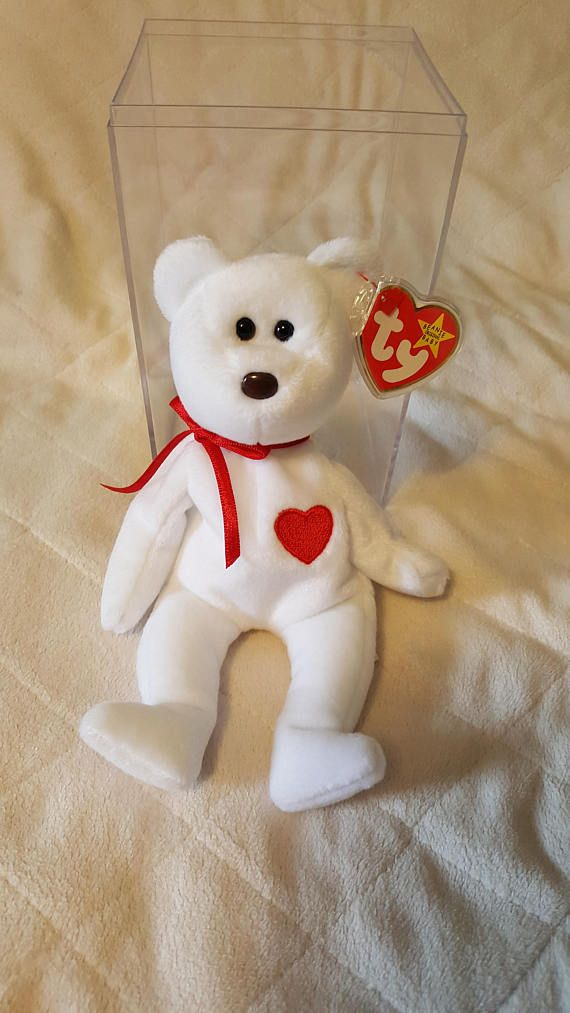 Rare Ty Valentino Beanie Baby in Brand New Mint Condition. He has never been played with and has been kept in an air-tight container away from dust and other elements, and kept in a smoke-free home. Comes with his own Cubbie Cube. This unusual bear has print mistakes in his tag,