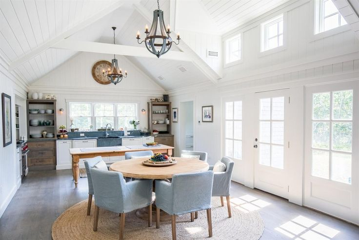 Cottage Kitchen with Wall sconce, Breakfast nook, L-shaped, Hardwood floors, Cathedral ceiling, Farmhouse sink, Exposed beam