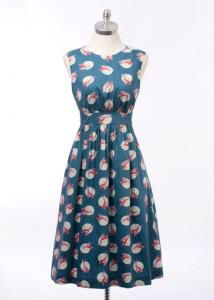 """Emily and Fin Lucy dress with a fun retro skier pattern and a gorgeous vintage inspired shape. Features a pleated, long length skirt. Fully lined. Has a 3/4 length zip on the back and two pockets on the front. Length 41"""".  http://www.coxandbaloney.com/webshop/1950s/lucy-dress-long-blue-skiiers/"""