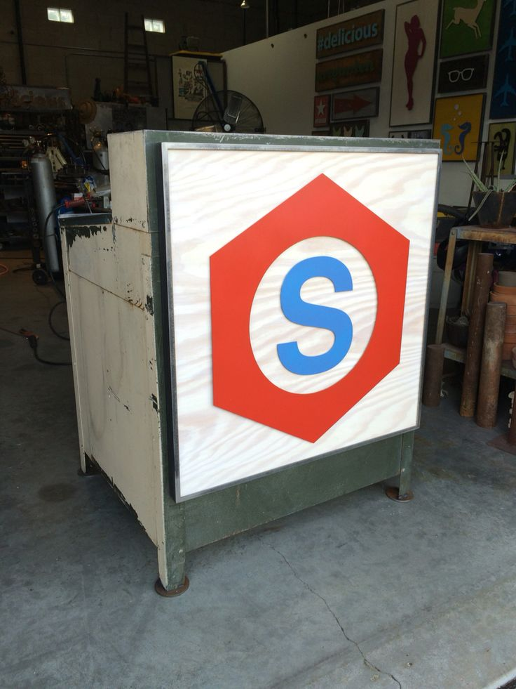 Hostess stand created from vintage 50s shipping desk.