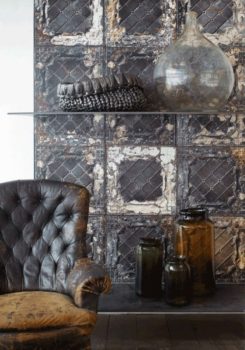 white walls | salvaged metal tiles | vintaged destroyed leather chair | living room | sitting area | glass shelves | glassware | clean interiors | bohemian home | eclectic inspired | living with style | stylish home | interior design | home decor ideas | inspiration |