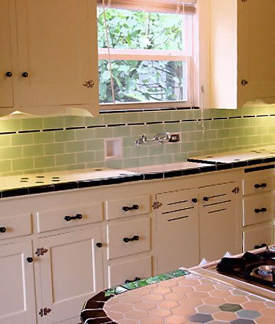 Vintage kitchen cabinets and tile backsplash and countertop. Perfection!