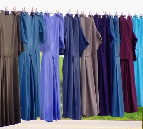 Why do the Amish wear Plain clothing?