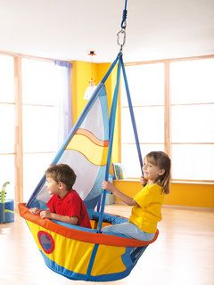 Ships See Saw Swing - Little captains see-saw sail through the room in this swing. Just throw out your anchor to go ashore. Includes a support. Static weight bearing up to 200 kg kg. Material: soft upholstered polyester, frame made of aluminum, sail made of nylon. $299.99